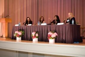 Panelists on the podium
